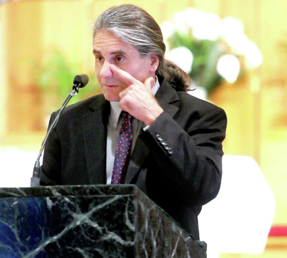 Jack Gambardella, Amy O'Neill's closest friend, delivers a eulogy for O'Neill at Saint Rita Church in Hamden. Arnold Gold/Register