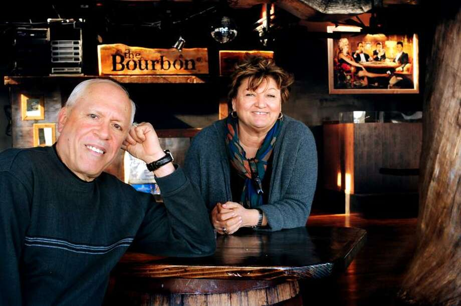 NEW HAVEN-DJ, Alan Kohn (L), and Owner, Guiliana Maravalle, at The Bourbon Room, a country rock club above Terminal110. The club is scheduled to open Sat. 2/25.   Melanie Stengel/Register