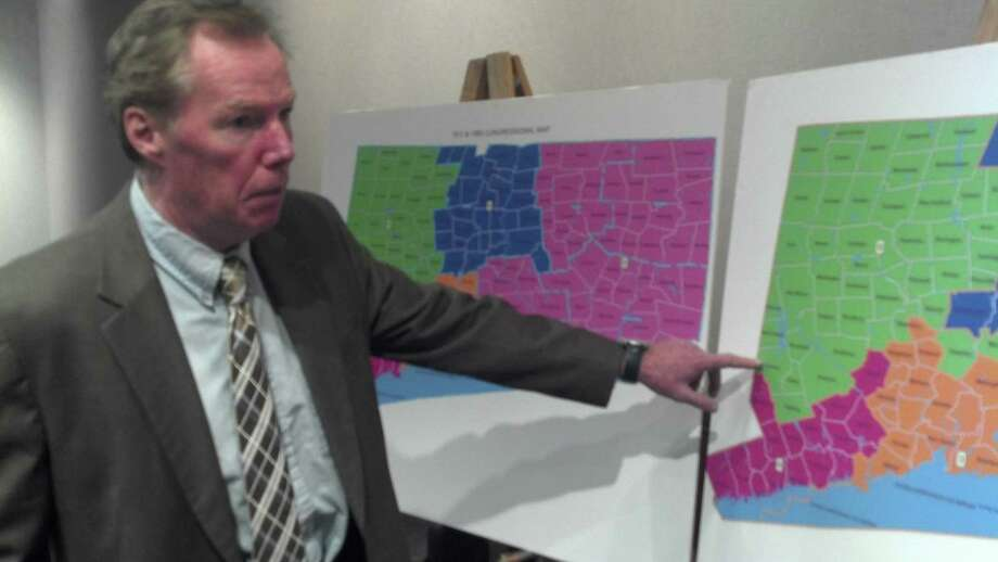 House GOP staffer Pat O'Neil sets up the various proposals for congressional redistricting.  Photo by Jordan Fenster