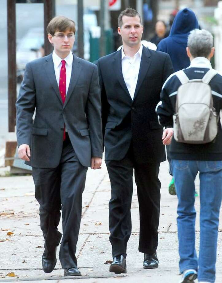 James Kos, left, and his brother, Matthew Kos, walk into Superior Court in New Haven in late November. Arnold Gold/Register file photo