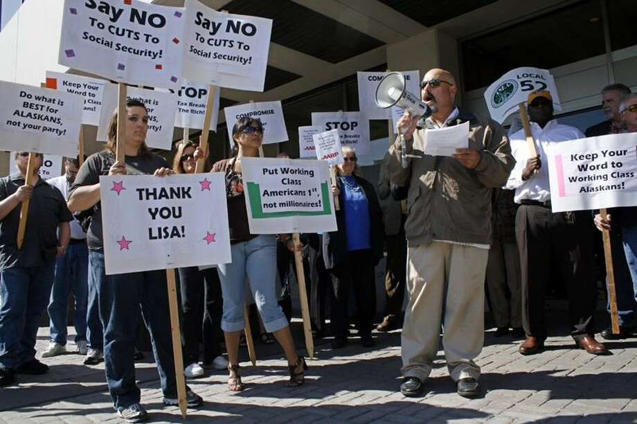 Members of the Alaska AFL-CIO protest outside the downtown office building where U.S. Sens. Mark Begich and Lisa Murkowski have offices in Anchorage, Alaska. Protesters said House Republicans were threatening the nation's economy and urged a compromise to head off an unprecedented default that would leave the Treasury without the funds needed to pay all its bills. (Associated Press) Photo: AP / AP2011