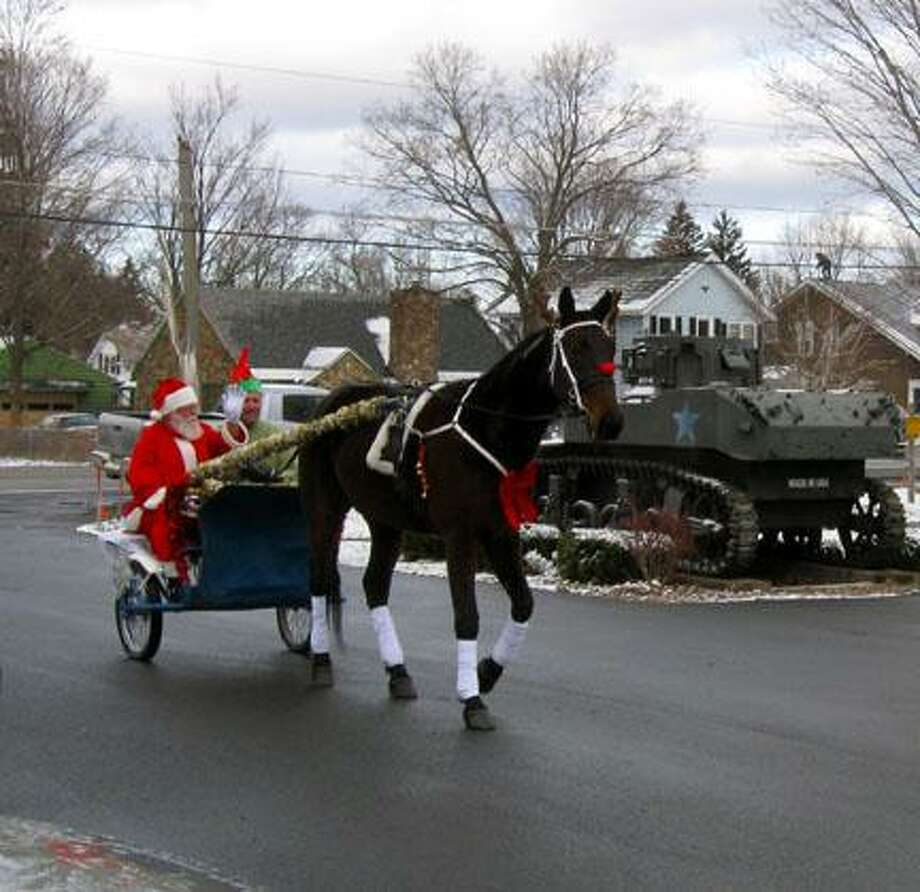 SUBMITTED PHOTOSanta is drawn by a race horse as he arrives at the Vernon American Legion childrenÕs Christmas party, which was held recently.