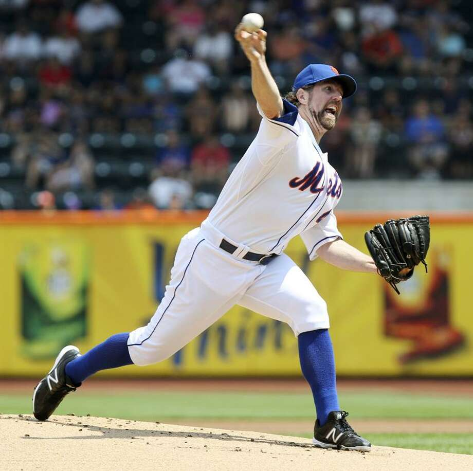 FILE - This Aug. 9, 2012 file photo shows New York Mets' R.A. Dickey pitching during the first inning of a baseball game against the Miami Marlins at Citi Field in New York. Dickey won the NL Cy Young Award, Wednesday, Nov. 14, 2012. (AP Photo/Seth Wenig, FIle) Photo: AP / AP