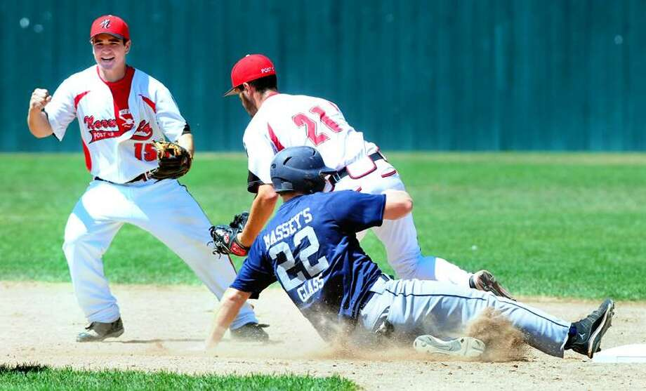 Anthony Pelligrino (bottom right) of Branford was caught off second base giving Norwalk a  double play opportunity in the fourth inning in the American Legion State Championship in Bristol on 7/30/2011.  Covering second for Norwalk is Eric Stenger.Photo by Arnold Gold/New Haven Register    AG0420D