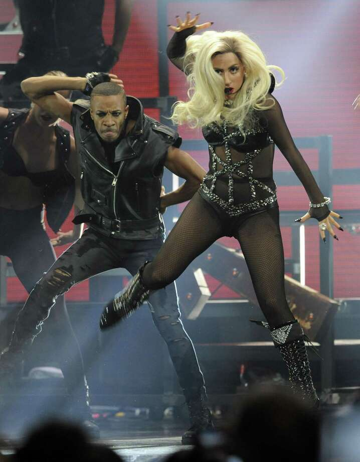 In this Sept. 24 file photo, Lady Gaga performs during the iHeartRadio music festival in Las Vegas. Lady Gaga has been voted the Associated Press Entertainer of the Year. (AP Photo/Chris Pizzello, file) Photo: ASSOCIATED PRESS / AP2011