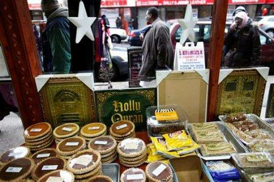 An assortment of halal foods and religious items are seen from inside Abdul Kareem Abdullah's cafe, as he is interviewed by the Associated Press regarding New York Police Department surveillance of the Muslim community in Newark, N.J., Wednesday, Feb. 15, 2012. Americans in New Jersey's largest city were subjected to surveillance as part of the New York Police Department's effort to build databases of where Muslims work, shop and pray. The operation in Newark was so secretive, even the city's mayor says he was kept in the dark. For months in mid-2007, plainclothes NYPD officers snapped pictures of mosques and eavesdropped in Muslim neighborhoods. The result was a 60-page report, obtained by The Associated Press. It cited no evidence of crimes. It was just a guide to Newark's Muslims. (AP Photo/Charles Dharapak)