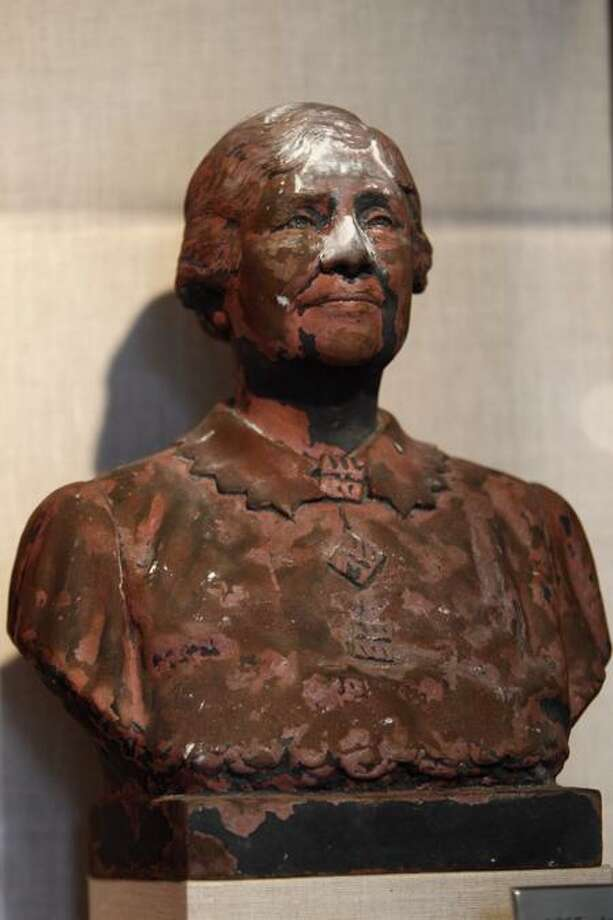 ADVANCE FOR USE SUNDAY, JULY 31, 2011 AND THEREAFTER - This Friday, June 24, 2011 photo shows a bust of Helen Keller scorched and covered in World Trade Center dust on display in New York. Besides ending nearly 3,000 lives, destroying planes and reducing buildings to tons of rubble and ash, the Sept. 11, 2001, attacks destroyed tens of thousands of records, irreplaceable historical documents and art. (AP Photo/Mary Altaffer) Photo: AP / AP
