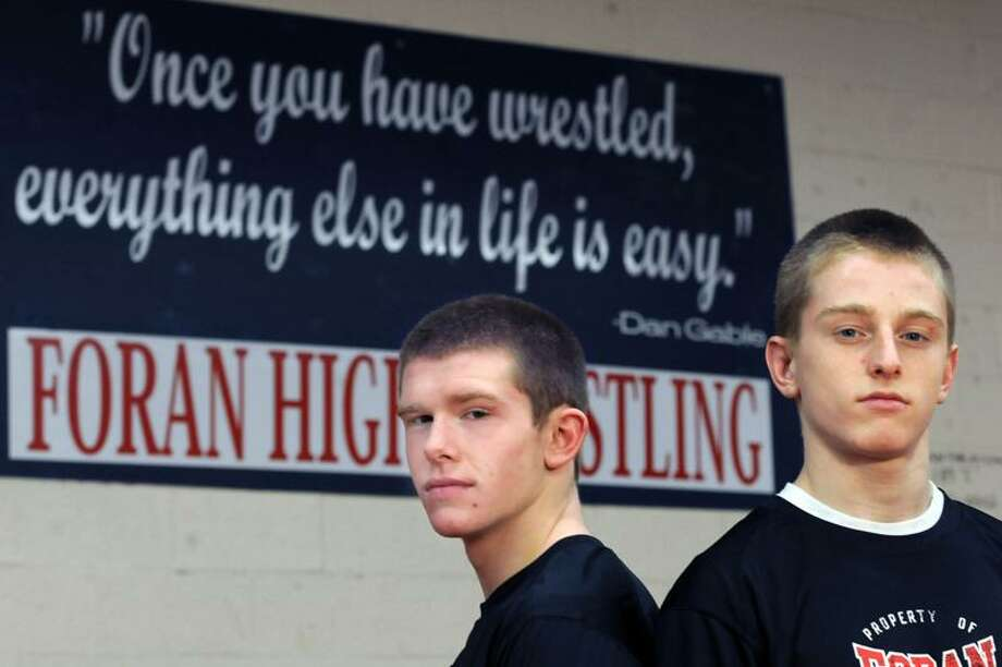Foran High School (Milford) wrestlers Clay Callahan left and Carl Luth right. Photo by Mara Lavitt/New Haven Register2/22/12