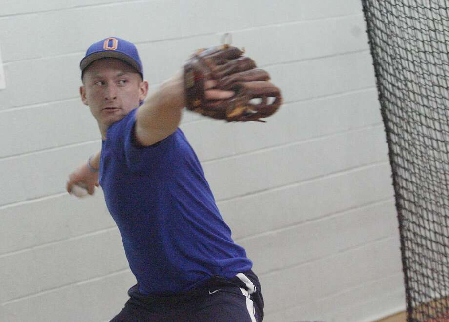 Dispatch Staff Photo by JOHN HAEGEROneida'sBrian Chevier works on a pitching drill on Tuesday, March 29, 2011.