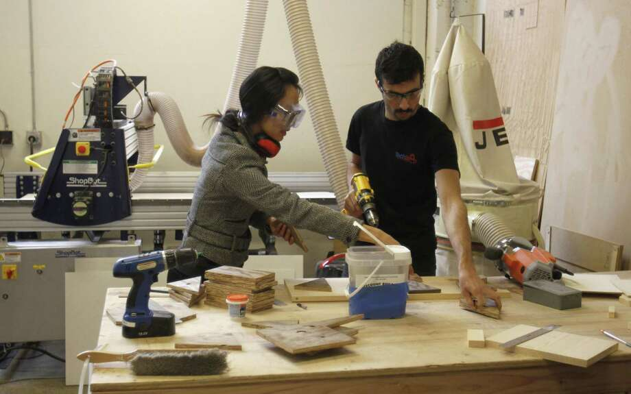 Members work on woodworking projects at TechShop in San Francisco. Modeled after gyms, TechShop is attracting members who pay as little as $100 a month to use industrial strength equipment to invent whatever they can imagine. (AP Photo/Ben Margot) Photo: ASSOCIATED PRESS / AP2011