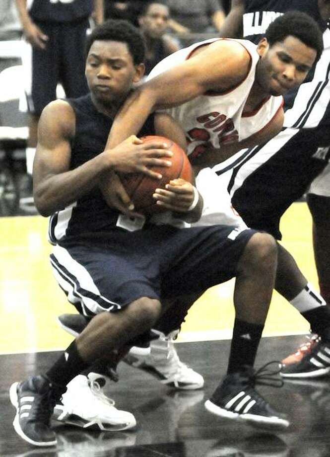 Bobby Bynum of Hillhouse fights for a loose ball against Justin Fredlaw of Wilbur Cross during the fourth quarter of Hillhouse's 47-40 win. Photo by Peter Hvizdak / New Haven Register