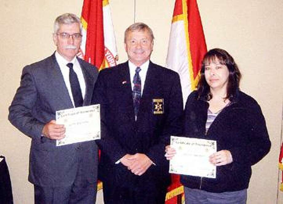SUBMITTED PHOTO Scott Bogardus, left, and Nicole Sawenko, of the Madison County Sheriff's Office, accept their certification of achievement from Sheriff Jack Mahar, (middle), Rensselaer County Sheriff's Office.