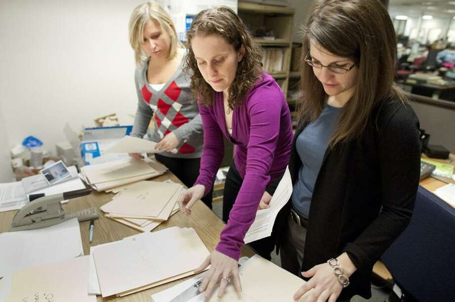 Vern Williams/Register photo: Register reporter Amanda Pinto, center, will be handing off the Register Matchmaking responsibilities to colleagues Alexandra Sanders, left, and Susan Misur.
