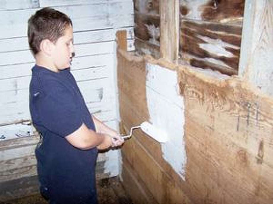 Photo Courtesy KIDS CLUB Members of the Oneida 4-H Kids Club helped paint the horse stalls at the Madison County Fairgrounds.