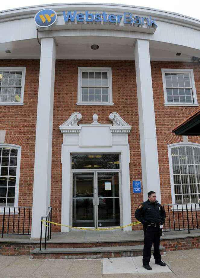Milford Police respond to a bank robbery at the Webster Bank in downtown Milford. Photo by Mara Lavitt/New Haven Register3/31/11