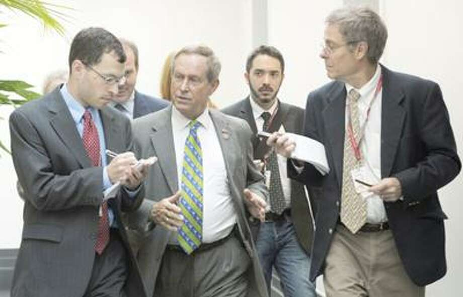 AP Photo Rep. Joe Wilson, R-S.C., is followed by reporters after leaving a caucus meeting on Capitol Hill in Washington Friday, July 29, 2011. Photo: AP / AP