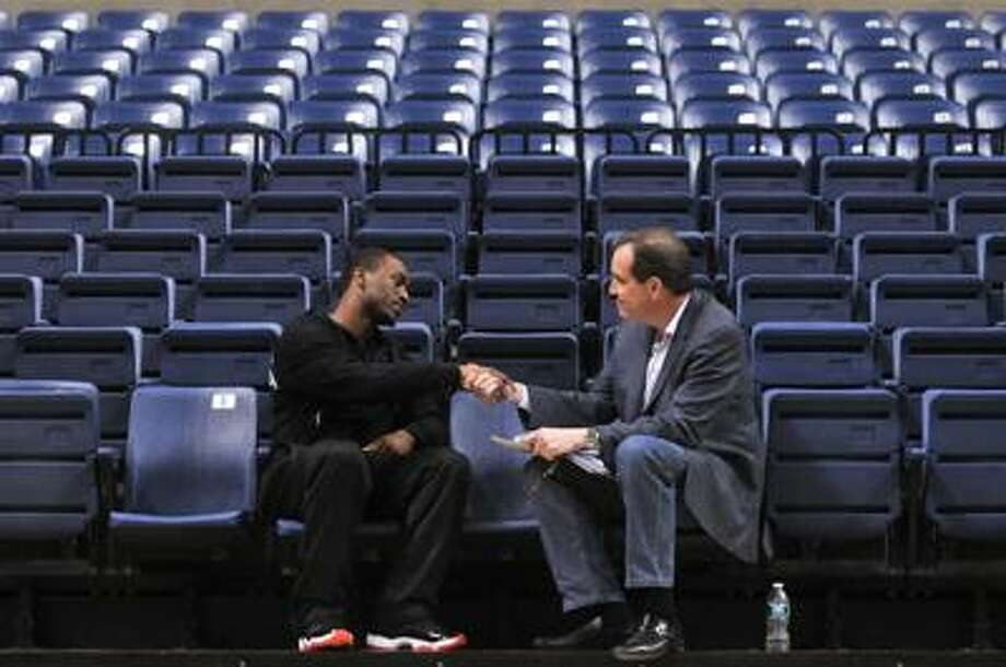 Storrs--Kemba Walker speaks to CBS sports reporter Jim Nantz at Gampel Pavilion Tuesday.  Photo by Brad Horrigan/New Haven Register-03.29.11.