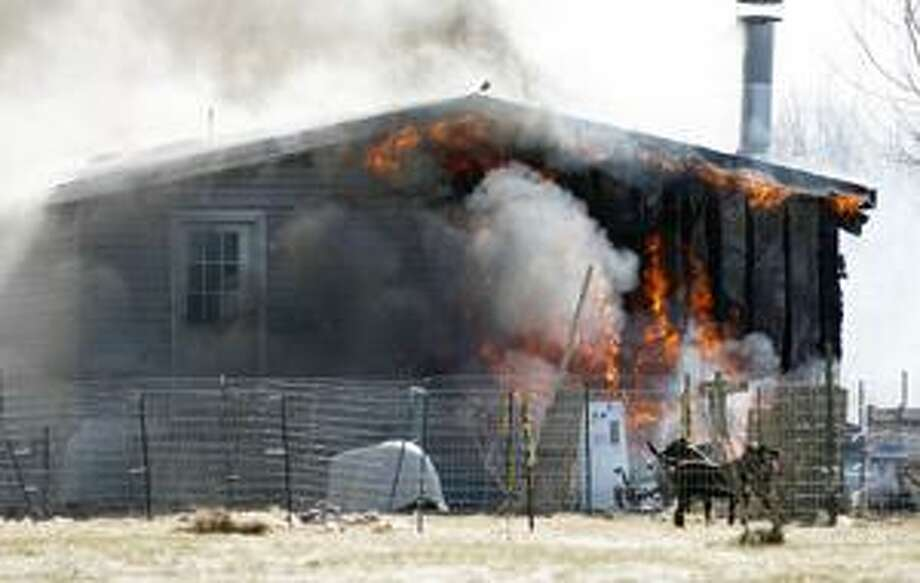 Fire crews battle a house fire on Irish Ridge Road in the Town of Verona on Wednesday, March 30, 2011.