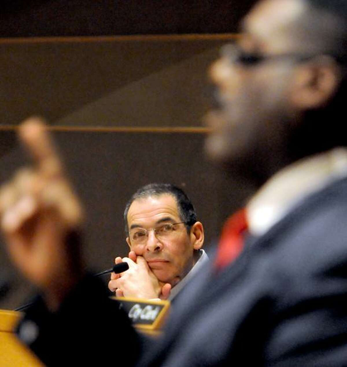 Outgoing New Haven Alderman Carl Goldfield listens to Alderman Charles A. Blango giving a final address Monday at the board's last meeting of the year. Photo by Peter Hvizdak / New Haven Register