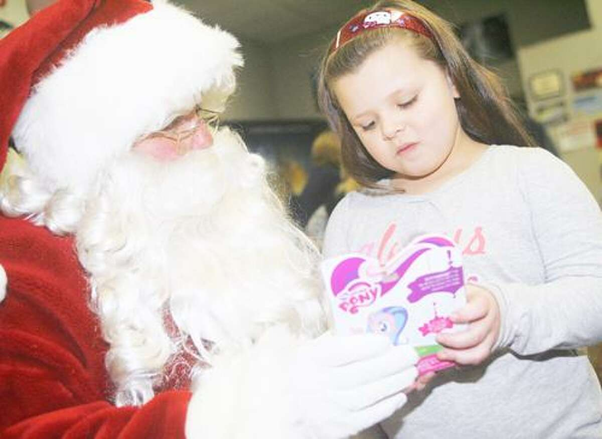 Photo by JOHN HAEGER (Twitter.com/OneidaPhoto) Adaline Catello, 6, of Oneida, talks with Santa before the start of the movie at Movie Plex in Oneida during the annual Oneida Firemen Benevolent Association's annual Holiday Party on Saturday, Dec. 17, 2011 in Oneida.