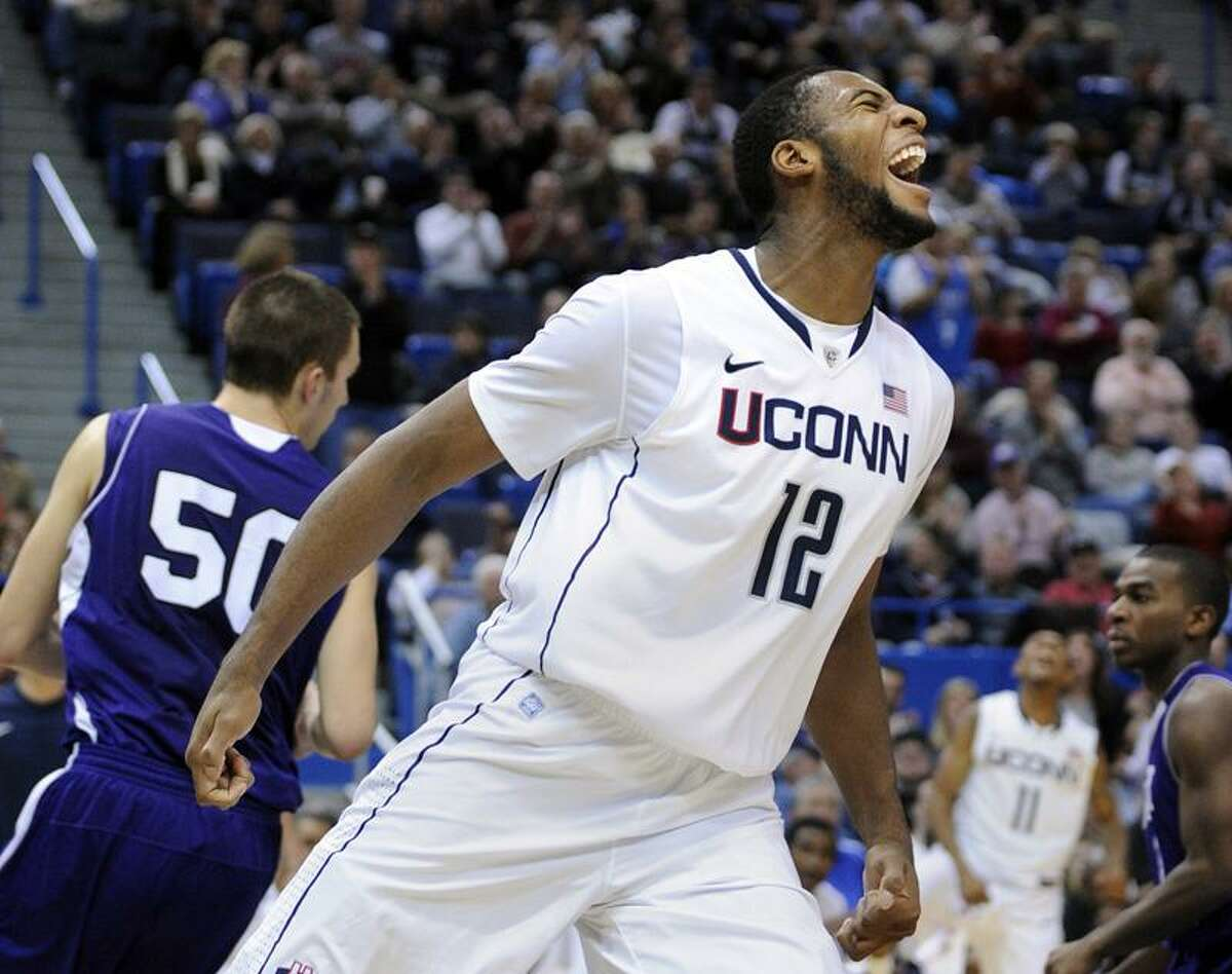 Connecticut's Andre Drummond (12) celebrates during the second half of an NCAA college basketball game in Hartford, Conn., on Sunday, Dec. 18, 2011. Drummond scored a game-high 24 points in his team's 77-40 victory over Holy Cross. (AP Photo/Fred Beckham)
