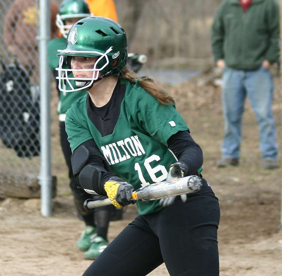 Submitted Photo by Jon Rathbun Rachel Holcomb lays down a bunt durning one of Hamilton's two wins at the Kristen Haver Memorial Tournament at Mudville March 31. The Emerald Knights beat Mount Markham 6-2 in the second game to claim the title.