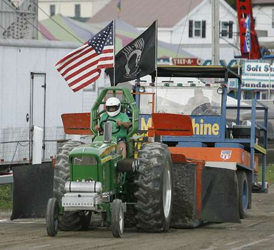 Dispatch Staff Photo by JOHN HAEGER(twitter.com/Oneidaphoto)Don Dusta of Ancrom, N.Y. pulls 393 feet 36 inches to win the 5,500 class of the tractor pull at the Boonville-Oneida County Fair on Thursday, July 28, 2011.
