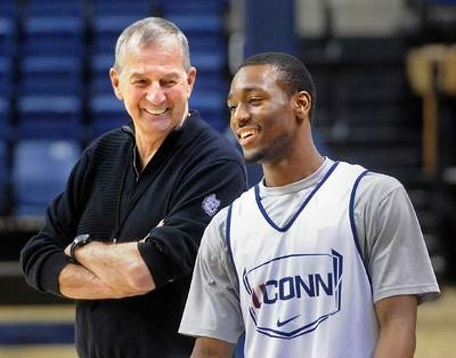 Storrs--Coach Jim Calhoun enjoys a laugh with Kemba Walker during practice at Gampel Pavilion Tuesday.  Photo by Brad Horrigan/New Haven Register-03.29.11.