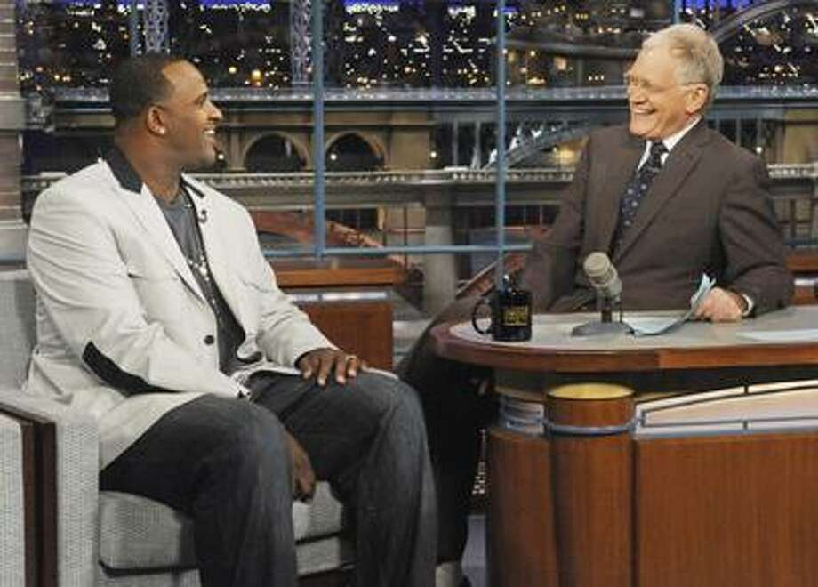 "In this photo released by CBS, New York Yankees' pitcher C.C. Sabathia, left, talks with host David Letterman on the set of the ""Late Show with David Letterman,"" Wednesday, March 30, 2011 in New York. Sabathia is scheduled to pitch Thursday, March 31, in the home opener against the Detroit Lions at Yankee Stadium. (AP Photo/CBS, Jeffrey Neira)  MANDATORY CREDIT; NO SALES; NO ARCHIVE; FOR NORTH AMERICAN USE ONLY Photo: AP / CBS"