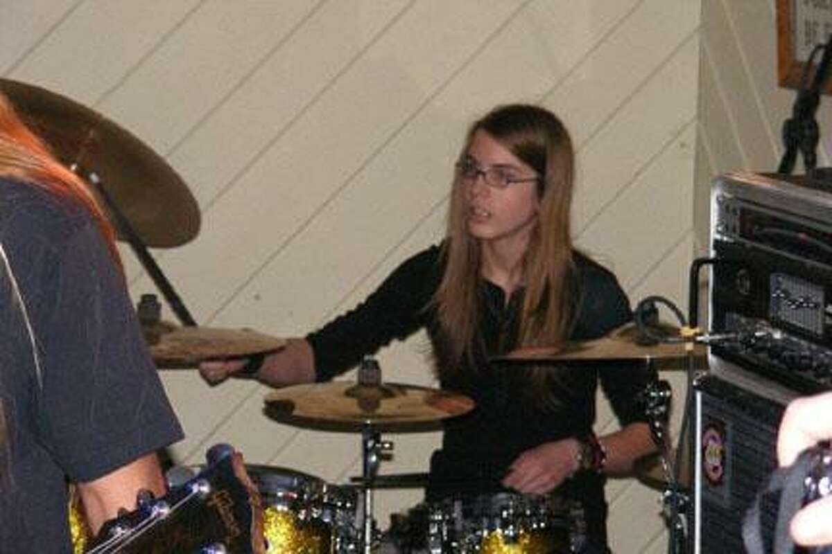 Photo Courtesy of ROY COSTONGunnar Coston, 14, of Oneida joins Ozzmageddon for a concert Saturday at 10 p.m. at the Madison House Restaurant. The band also features his dad Roy Coston on guitar, James Cross on lead vocals, and Vinny G. on bass.