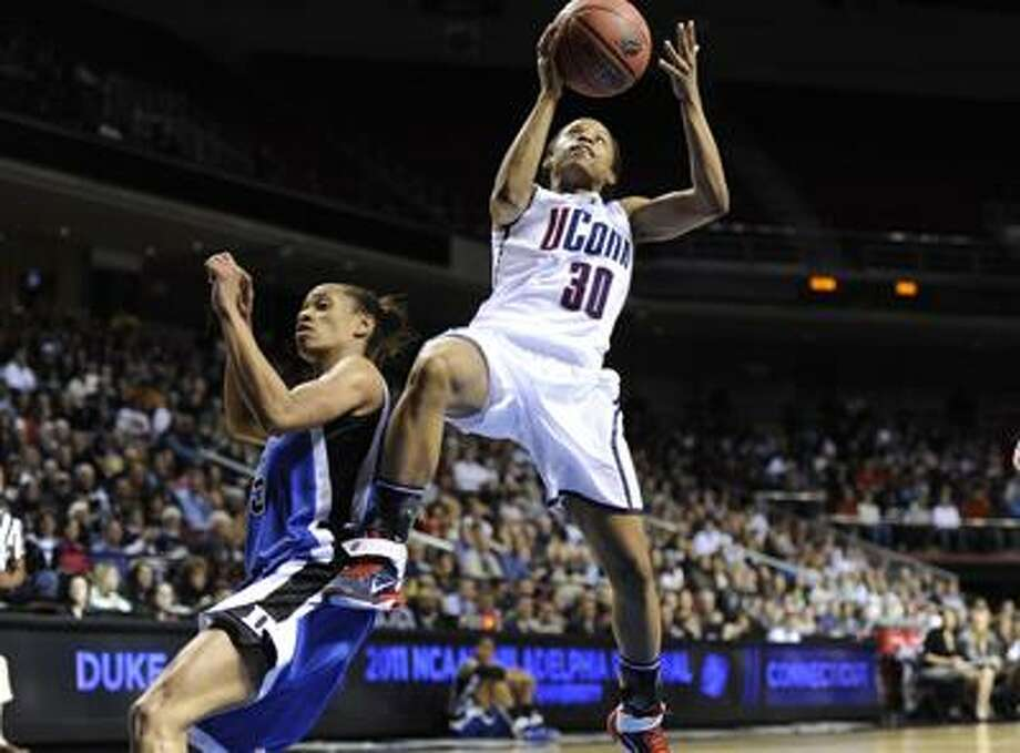 Connecticut guard Lorin Dixon (30) shoots past Duke guard Jasmine Thomas (5) in the first half of an NCAA women's college basketball tournament regional final, Tuesday, March 29, 2011, in Philadelphia. (AP Photo/Barbara Johnston) Photo: AP / Barbara Johnston