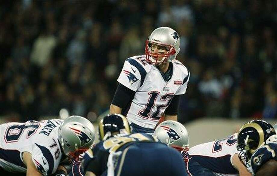 New England Patriots quarterback Tom Brady, in action during the first half of a NFL football game at Wembley Stadium, London, Sunday, Oct. 28, 2012. (AP Photo/Matt Dunham) Photo: AP / AP