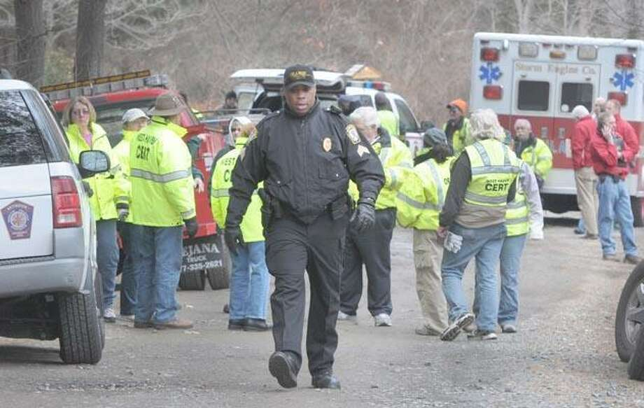 An Orange police officer walks out of the Racebrook Public Recreational area last Tuesday afternoon on Route 114 Racebrok Road where volunteers, emergency and law enforcement personnel where looking for Isabella Oleschuk.  Photo by Peter Hvizdak / New Haven Register    March 22, 2011       ph2278               #1058     Connecticut