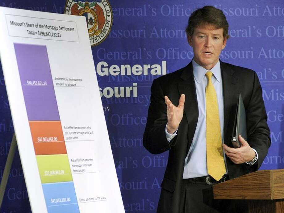 In this Feb. 9, 2012, photo, Missouri Attorney General Chris Koster stands in front of a chart in Jefferson City, Mo., showing the proposed distribution of the state's $196,842,222.21 share of a settlement with the nation's top mortgage lenders. Of that amount, $41 million would be paid directly to the state government to spend as it chooses and Gov. Jay Nixon plans to use nearly all of it to help shore up the budget. He's not the only politician eyeing the cash for purposes that have nothing to do with foreclosure. Associated Press Photo: AP / FR19832 AP