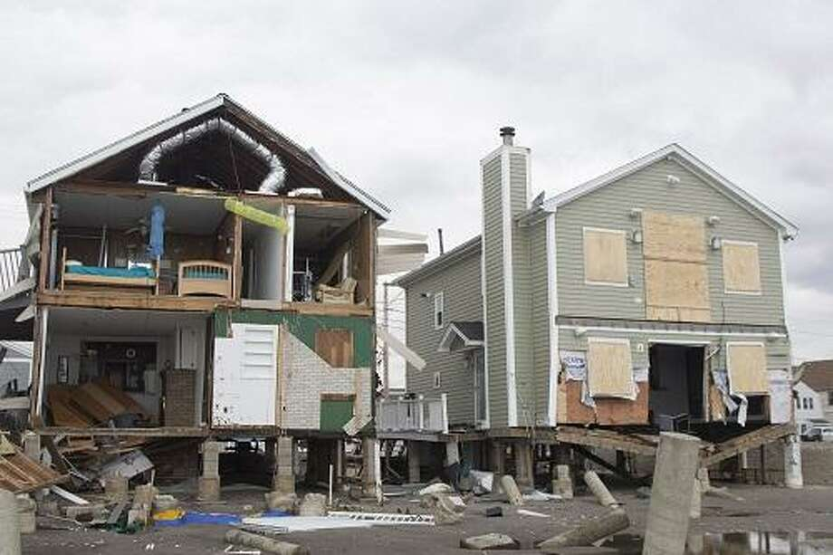 Several waterfront houses on East Broadway were decimated by storm Sandy. Photo By Rich Scinto.