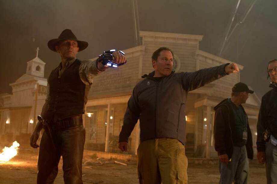 "Universal Pictures photo: That's some newfangled six-shooter all right: star Daniel Craig, left, and director Jon Favreau on the set of ""Cowboys & Aliens."" Photo: AP / Universal Studios and DreamWorks II Distribution Co. LLC"