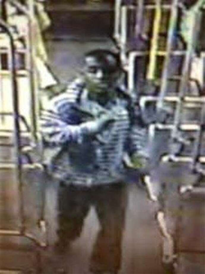 This image from video provided by the Los Angeles County Sheriff's Department shows a suspect officials say is accused of raping a mentally disabled woman on a city bus. Police say the suspect boarded the bus with the woman in Culver City, followed her to the back of the bus and forced himself on her late Wednesday, Nov. 7, 2012. A lone witness tried to alert the bus driver that the rape was happening, but it continued for about 10 minutes until the suspect stopped and exited the bus. (AP Photo/Los Angeles County Sheriff's Department) Photo: AP / Los Angeles County Sheriff's Department