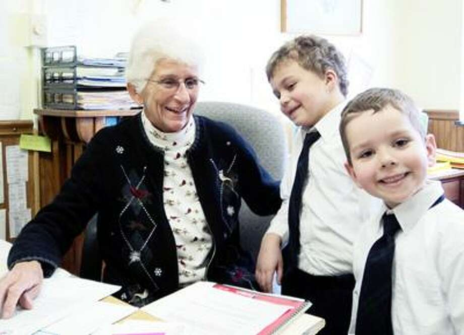 Photo Courtesy ST. PATRICK'S ELEMENTARY From left are Principal of St. Patrick's School, Peg Brown, and students, Quinn Jennings and Aden Sherlock