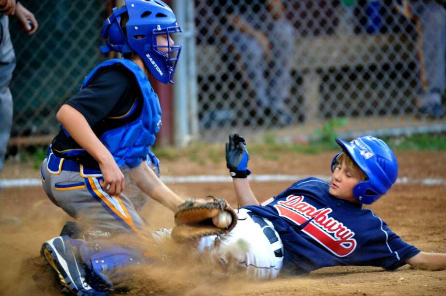 Danbury Timmy MacDonaled is taged out at home in the second inning by Brookfield catcher John Garizio during the Al Leonard  Invitational, Jimmy Fund 10 year old boys championship Thursday June 17, 2010 Danbury vs. Brookfield. (Photo/Douglas Healey for The News-Times). Photo: Douglas Healey / News-Times Freelance