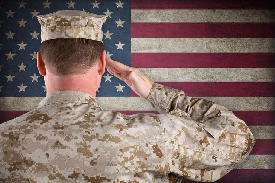 Marine Salutes an American Flag Photo: Getty Images/iStockphoto / iStockphoto