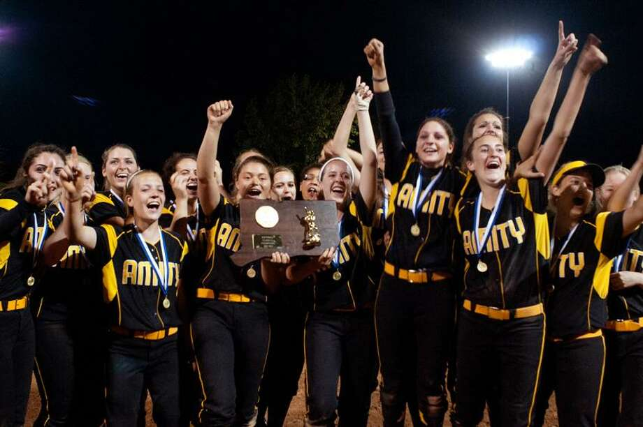 Amity celebrates winning the Class LL state championship Friday night at DeLuca Field in Stratford. The sixth-seeded Spartans beat No. 1 Southington 10-6. (Melanie Stengel/Register)