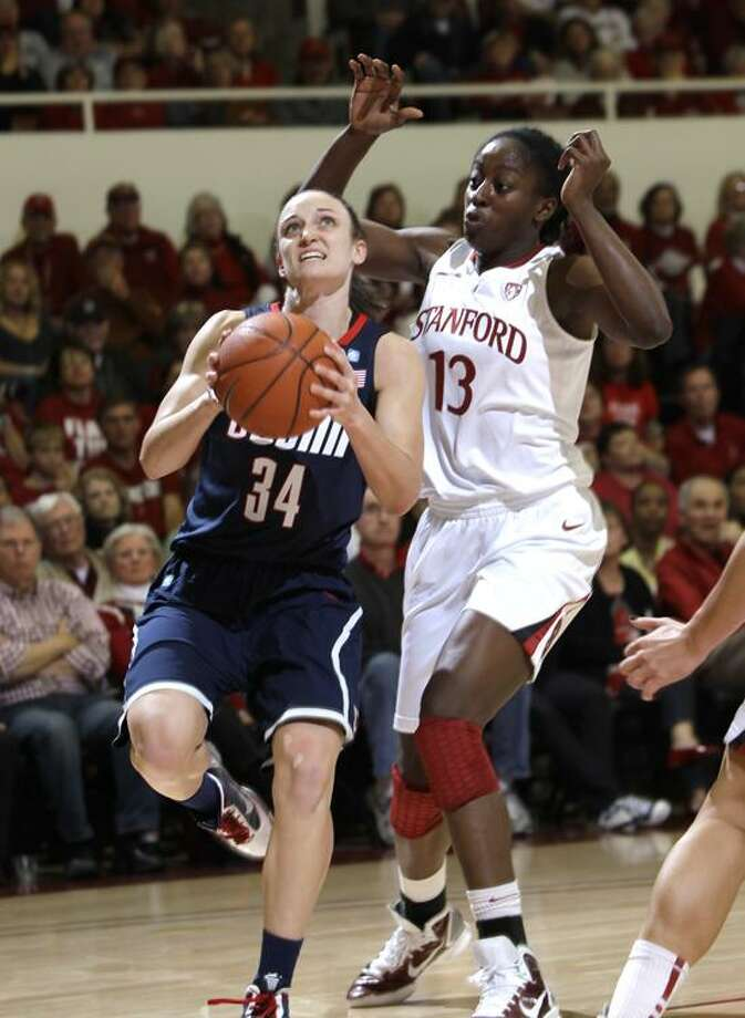 Connecticut guard Kelly Faris (34) and Stanford forward Chiney Ogwumike (13) in an NCAA college basketball game in Stanford, Calif., Thursday, Dec. 30, 2010. Stanford upset Connecticut 71-59. (AP Photo/Paul Sakuma) Photo: AP / AP2010