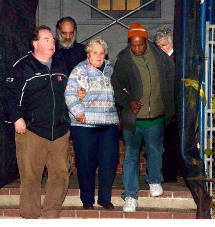 Lois Krakowski is helped down the steps of Superior Court in Milford.  Krakowski's granddaughter, Ashlie Krakowski, was killed traffic accident in 2009, when the vehicle in which she was a passenger was struck by former Milford police officer Jason Anderson.   Melanie Stengel