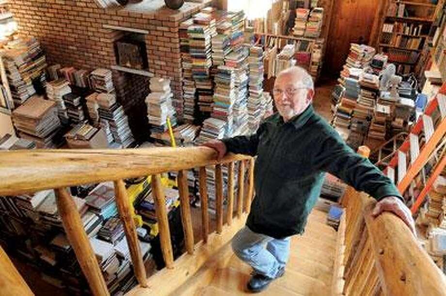 Bookseller and collector Elliot Ephraim in his North Branford barn that houses the bulk of his books. (Mara Lavitt/Register)