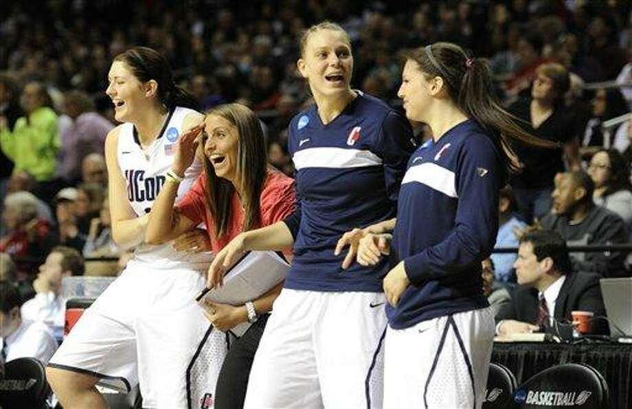 Connecticut's bench celebrates as they take the lead against Georgetown in the second half of an NCAA women's college basketball tournament regional semifinal on Sunday in Philadelphia. Connecticut won 68-63. (AP Photo/Barbara Johnston) Photo: AP / Barbara Johnston