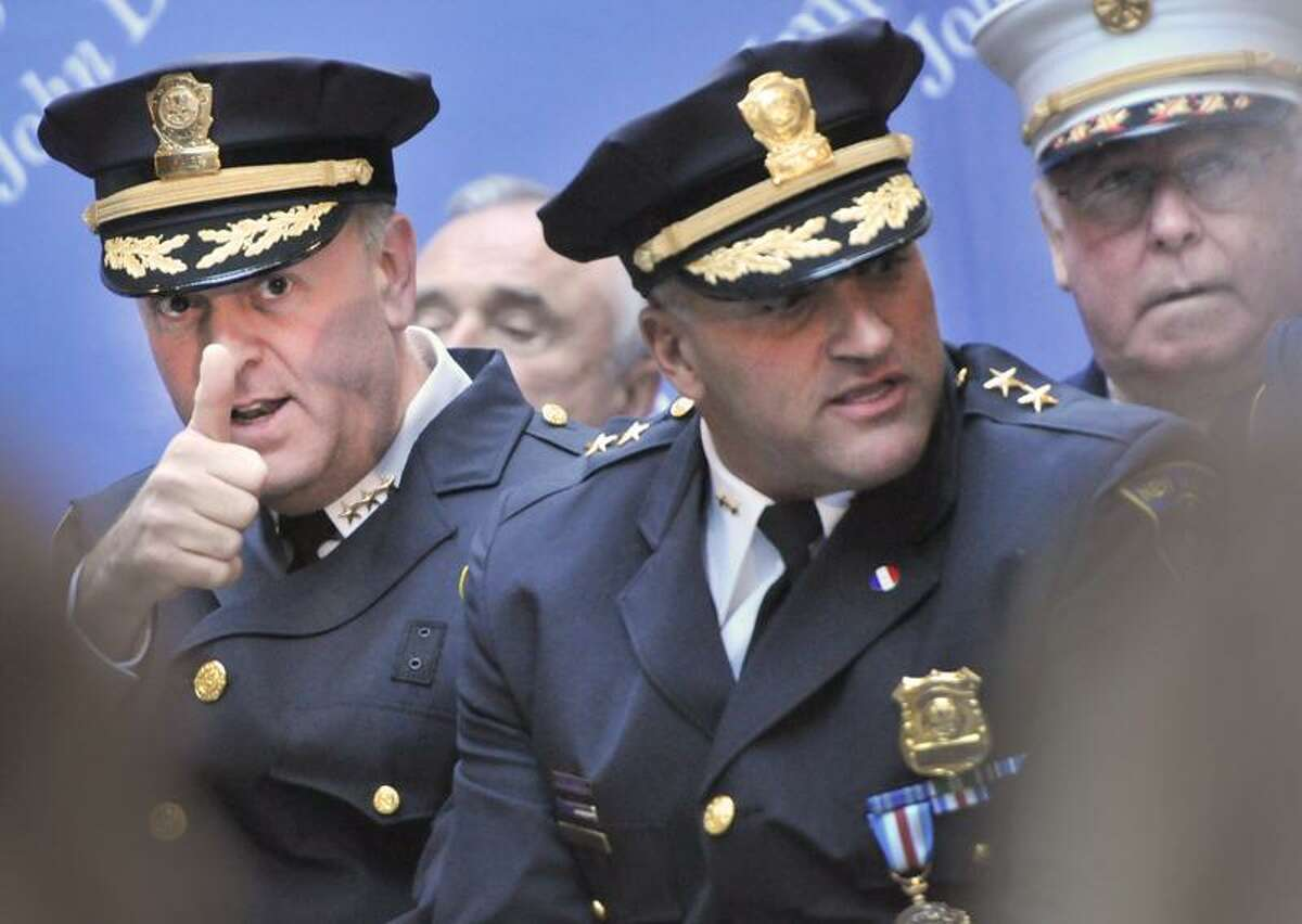 In this Nov. 18 file photo, Dean M. Esserman, left, gives a thumbs up to a member of the audience before his swearing in ceremony at New Haven City Hall as the New Haven Police Chief. Sitting with Esserman is Assistant Police Chief John Velleca, center, and New Haven Fire Chief MIchael Grant, right. Velleca confirmed Monday he will retire in January. (Photo by Peter Hvizdak/New Haven Register) November 18, 2011 ph2411 # Connecticut