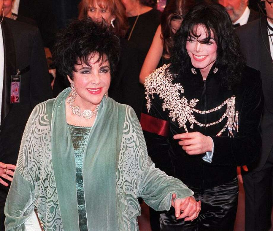 FILE - This Feb. 16, 1997 file photo shows Elizabeth Taylor arriving with Michael Jackson at the Pantages Theater in Los Angeles for her birthday celebration. Publicist Sally Morrison says the actress died Wednesday, March 23, 2011 in Los Angeles of congestive heart failure at age 79. (AP Photo/Chris Pizzello, File) Photo: ASSOCIATED PRESS / AP1997