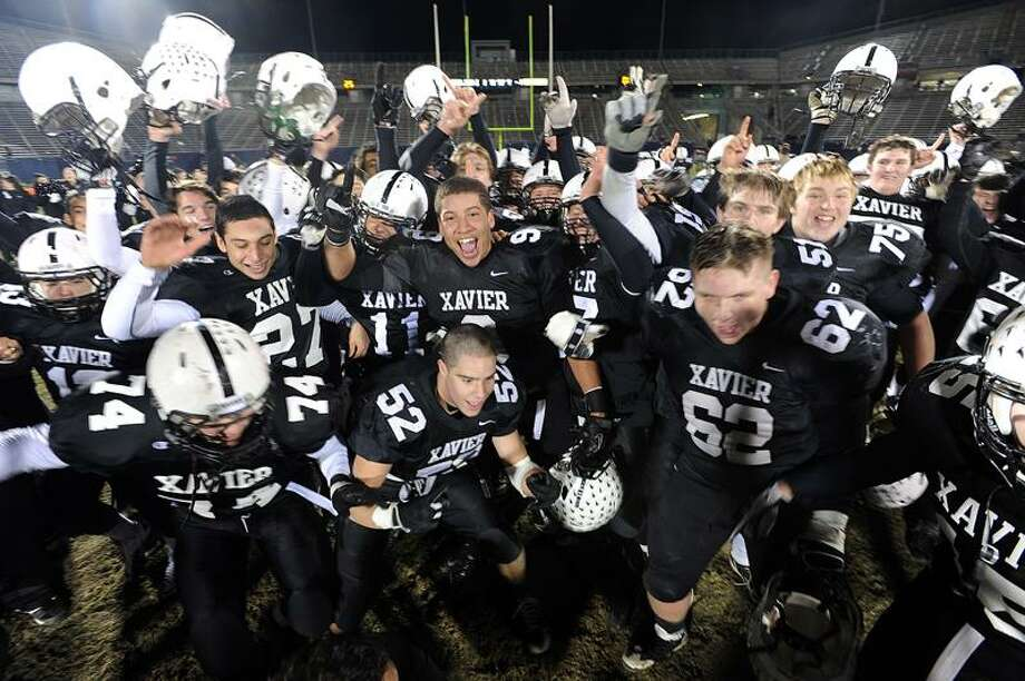 Hartford-- Xavier celebrates their Class LL State Championship win over Staples.  Peter Casolino/New Haven Register12/10/11