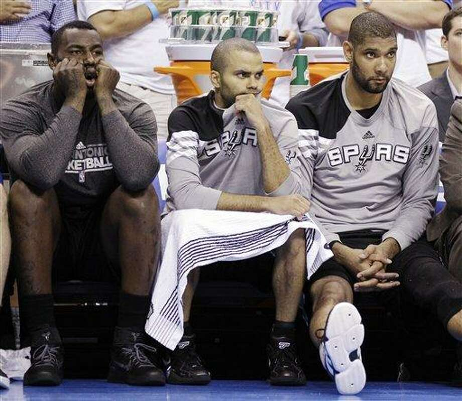 From left, San Antonio Spurs forward DeJuan Blair, point guard Tony Parker, of France, and center Tim Duncan watch action against the Oklahoma City Thunder during the second half of Game 6 in the NBA basketball Western Conference finals, Wednesday, June 6, 2012, in Oklahoma City. (AP Photo/Eric Gay) Photo: ASSOCIATED PRESS / AP2012
