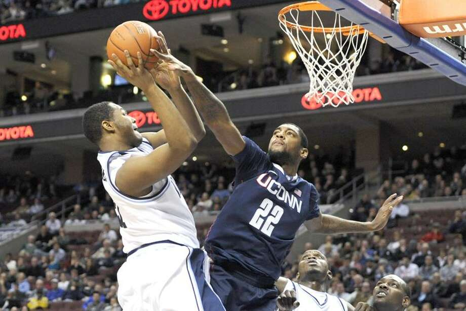 Feb 20, 2012; Philadelphia, PA, USA; Connecticut Huskies forward Roscoe Smith (22) blocks the shot of Villanova Wildcats forward Markus Kennedy (21) during the first half at the Wells Fargo Center. Mandatory Credit: Howard Smith-US PRESSWIRE Photo: US PRESSWIRE / (2012) Howard Smith